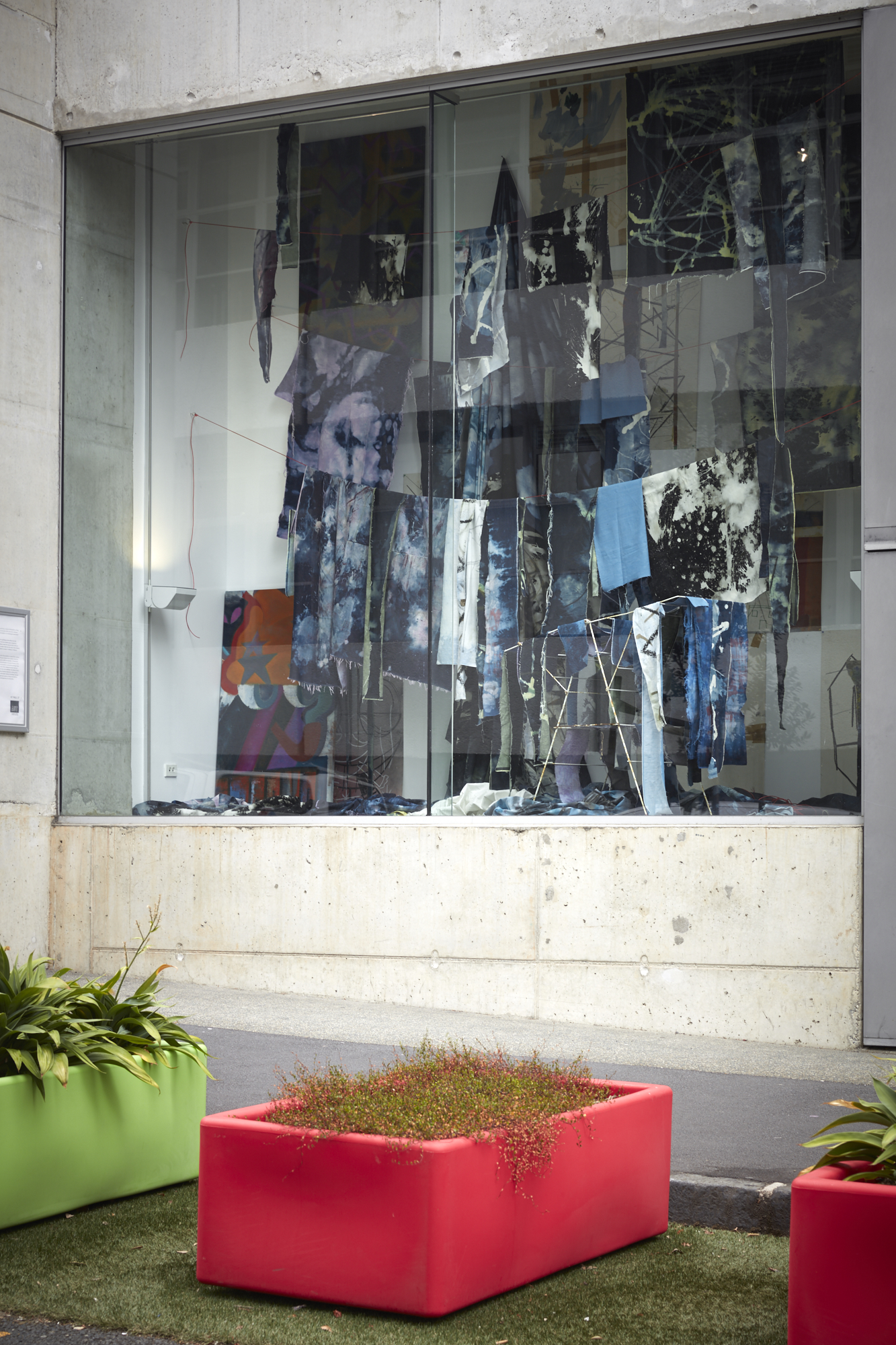 denim artwork, hanging in window. Photograph taken from street view