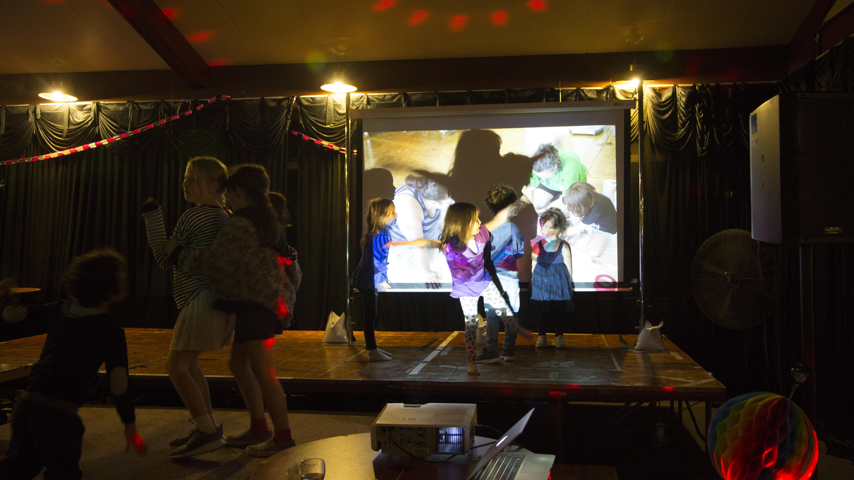 Group gathering, kids dancing