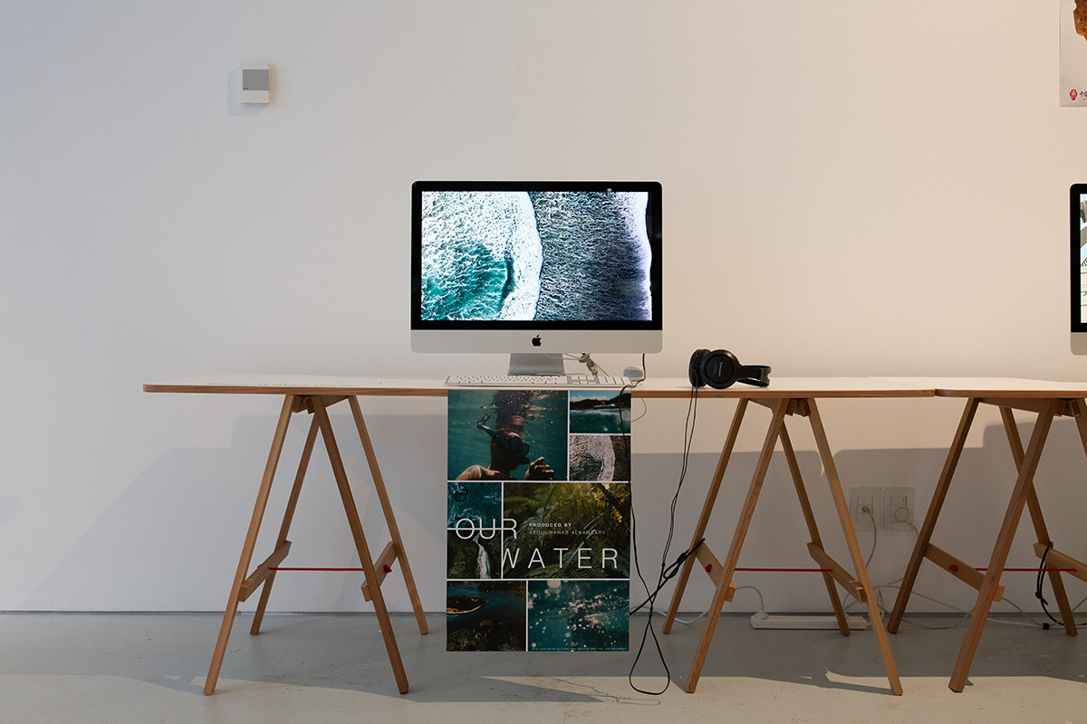 Computer with a looped video and poster