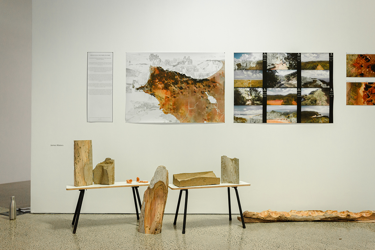 Wood displayed on low tables, prints on wall