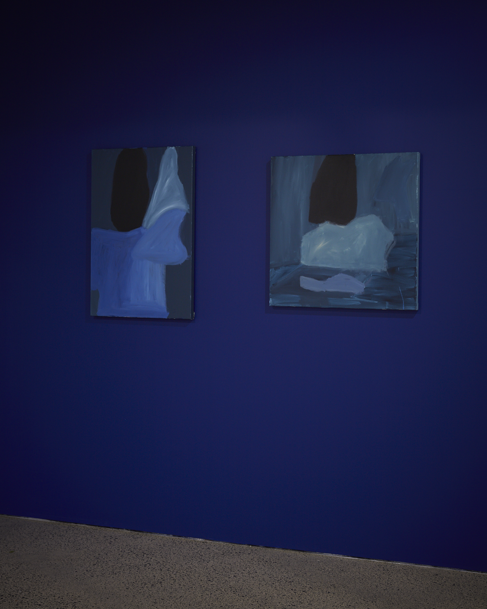 two paintings, blue wall