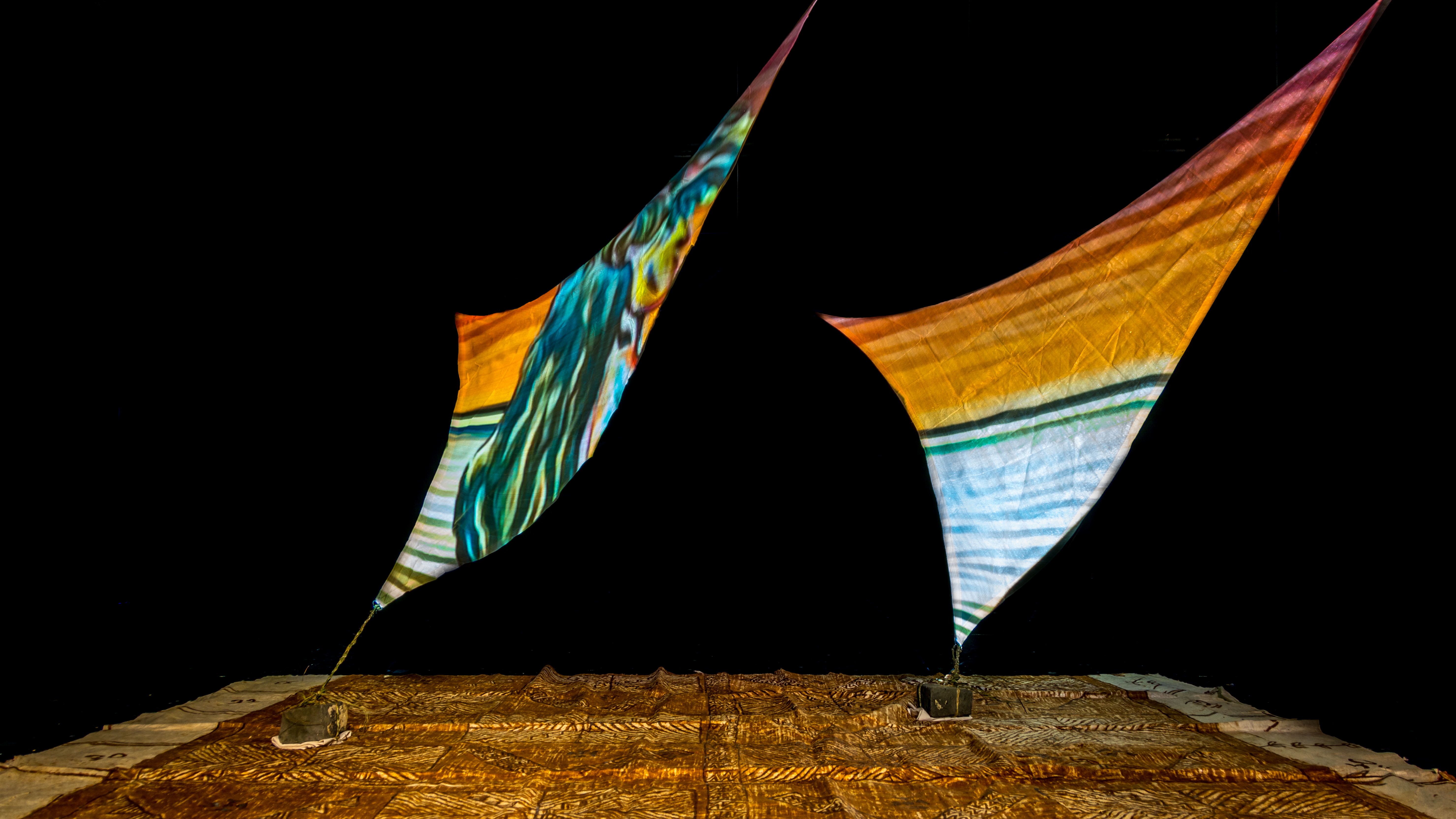 Projections onto rā sails installed with tapa underneath