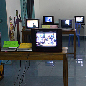 A community classroom was converted into a multi-channel video installatoin by Sa Sa Art Projects' students during Snit Snaal (2012). Some of the TVs were borrowed from the White Building residents.
